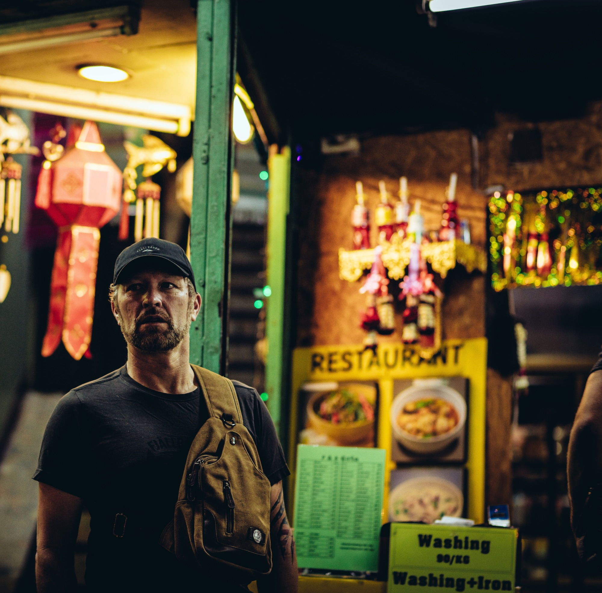 An Exodus Road investigator stands on a Thai street at night.
