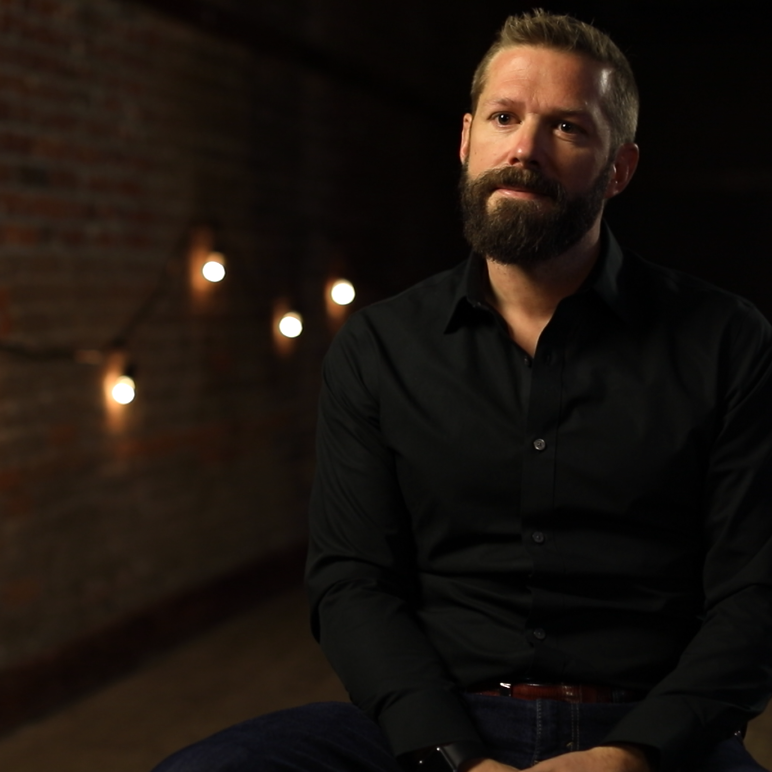 Matt Parker, CEO and CO-Founder of The Exodus Road sits in an interview setting.