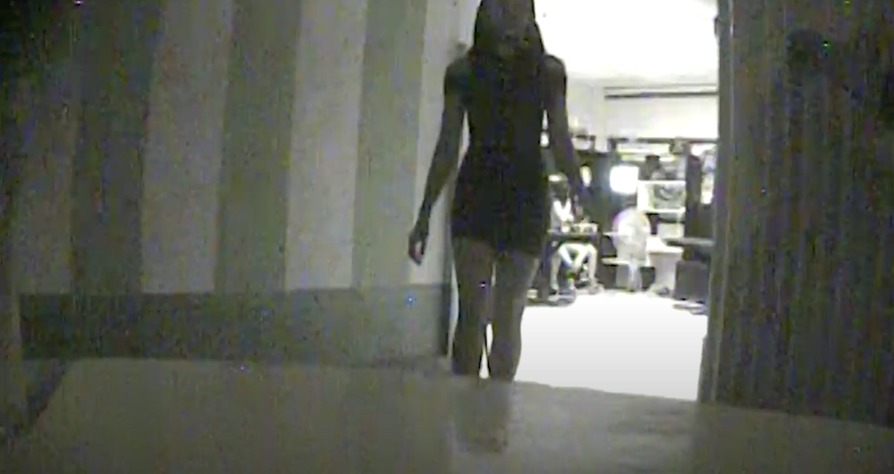 A female victim of human trafficking is captured on undercover footage as she walks into a room to meet with an undercover investigator.