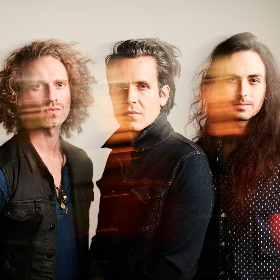 Image of Remedy Drive band members.