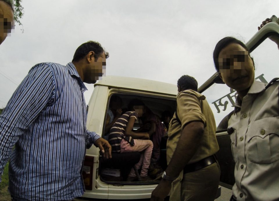 Law Enforcement officers care to young female survivors in India.