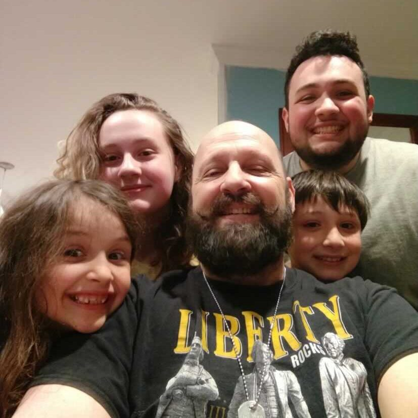 Search + Rescue Community Member, Tyrone, alongside his four kids.